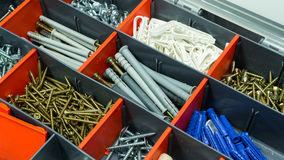 A box with screws, dyupels, fasteners. Stock Photography