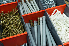 A box with screws, dyupels, fasteners. Stock Photo