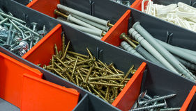 A box with screws, dyupels, fasteners. Stock Images