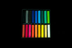 Box set of chalk. A box set of Colored chalk sticks isolated on black background Royalty Free Stock Photography