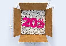 Box with shipping peanuts and 20 percent off sign Stock Images