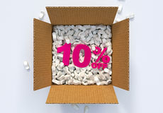 Box with shipping peanuts and 10 percent off sign Stock Images
