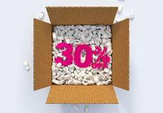 Box with shipping peanuts and 30 percent off sign Stock Photography