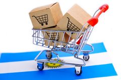 Box with shopping cart logo and Argentina flag : Import Export Shopping online or eCommerce delivery service store. Product shipping, trade, supplier concept royalty free stock photo