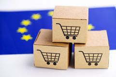 Box with shopping cart logo and The European Union (EU) flag : Import Export Shopping online or eCommerce delivery. Service store product shipping royalty free stock images