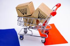 Box with shopping cart logo and France flag : Import Export Shopping online or eCommerce delivery service store product shipping. Trade, supplier concept stock image