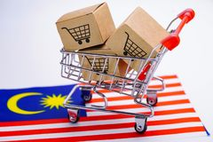 Box with shopping cart logo and Malaysia flag : Import Export Shopping online. Or eCommerce delivery service store product shipping, trade, supplier concept royalty free stock image
