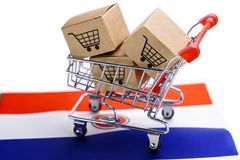 Box with shopping cart logo and Netherlands flag : Import Export Shopping online or eCommerce delivery service store product shipp. Ing, trade, supplier concept stock photo