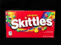 Box of Skittles Candy on a black backdrop. A box of Skittles Candy.  Taste the Rainbow Stock Photos
