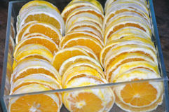 Box of sliced fresh oranges Stock Photos
