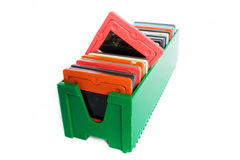 Box with slides. Green plastic box with of different colors slides Royalty Free Stock Images