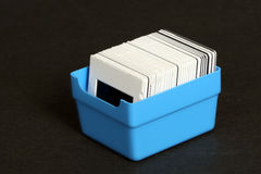 Box with slides. Isolated on black background Royalty Free Stock Photo