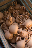 Box with small brown clay jars Stock Image