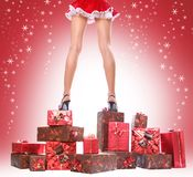 Box and snow. Sexy young Santa-girl with gift boxes Stock Image