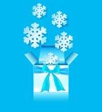 Box and snowflakes Stock Photos
