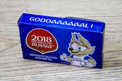 Box with souvenir sweets for the world Cup in Russia in 2008 on wood background. stock photography