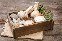 Box with spa cosmetics, accessories and orchid. On wooden background Stock Photography