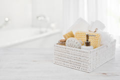 Box with spa products on wood over blurred bathroom interior Royalty Free Stock Photography