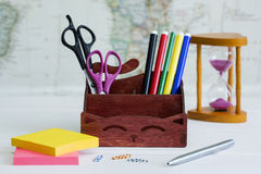 A box with stationery. On the map background stock photos