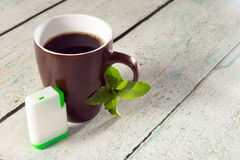 Box of stevia tablets and coffee. Little white box of stevia tablets as sweetener for a mug of coffee Stock Image