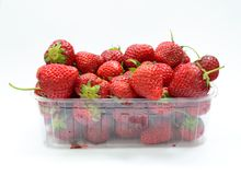 Box with strawberries Stock Images