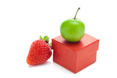 Box,strawberry and green plum Royalty Free Stock Image