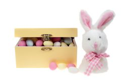 Box of sugar covered almonds sweets with bunny Royalty Free Stock Photos