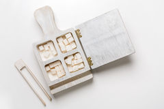 Box with sugar cubes and tongs isolated on white Stock Photos