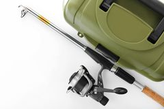 Box for tackle and fishing rod stock photos