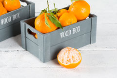Box of tangerines Stock Images