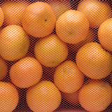 Box of tangerines with red net Royalty Free Stock Photo