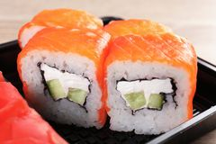 Box with tasty sushi rolls, closeup. Food delivery service royalty free stock photography