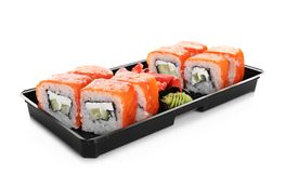Box with tasty sushi rolls on white background. Food delivery stock images