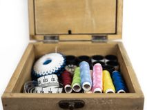 Box with threads and other sewing equipment royalty free stock photography