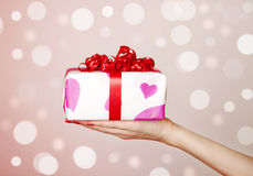 Box tied with a red satin ribbon bow. Royalty Free Stock Image