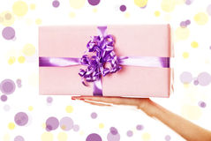 A box tied with a violet satin ribbon bow. Royalty Free Stock Images