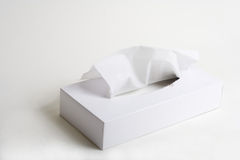 Box of tissue. Tissue and box on bright background Royalty Free Stock Photos
