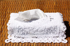 Box of tissues. A box of tissues in a fancy dressing on a brown wicker background Stock Images