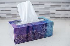 Box of Tissues on Bathroom Counter. Box of tissues on counter in bathroom ready for cold and flu season Royalty Free Stock Photography