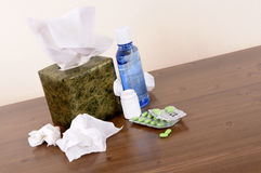 Box of tissues with cold and flu medicine on a wood table, winter healthcare concept Stock Images