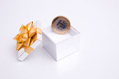 Box to gift and coin Stock Image
