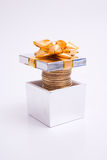 Box to gift and coin Stock Photos