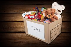 Toys collection in box  isolated on  background. Box toys collection color play fun red Stock Images