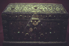 Box treasures of gold and precious jewels, cross and religious s Royalty Free Stock Images