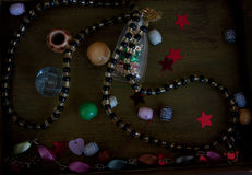 Box with trinkets. Wooden box for needlework with sequins, beads, and bracelets Royalty Free Stock Photo