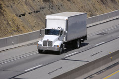 Box Truck on Highway. White Box Truck on Highway royalty free stock image