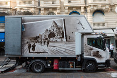 A box truck with vintage postcard decoration. Nice, France - November 3, 2016: A Box truck with decorated container with vintage 1920 postcard of Promenade des stock images