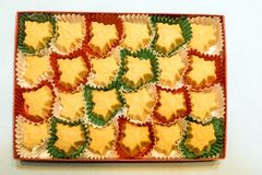 Box of twenty four Vermont organic maple sugar candies. In red and green paper liners, two dozen Stock Images