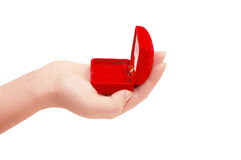 Box under a jewel in a hand Stock Photography