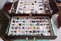 Box with various natural stones for decoration royalty free stock photography